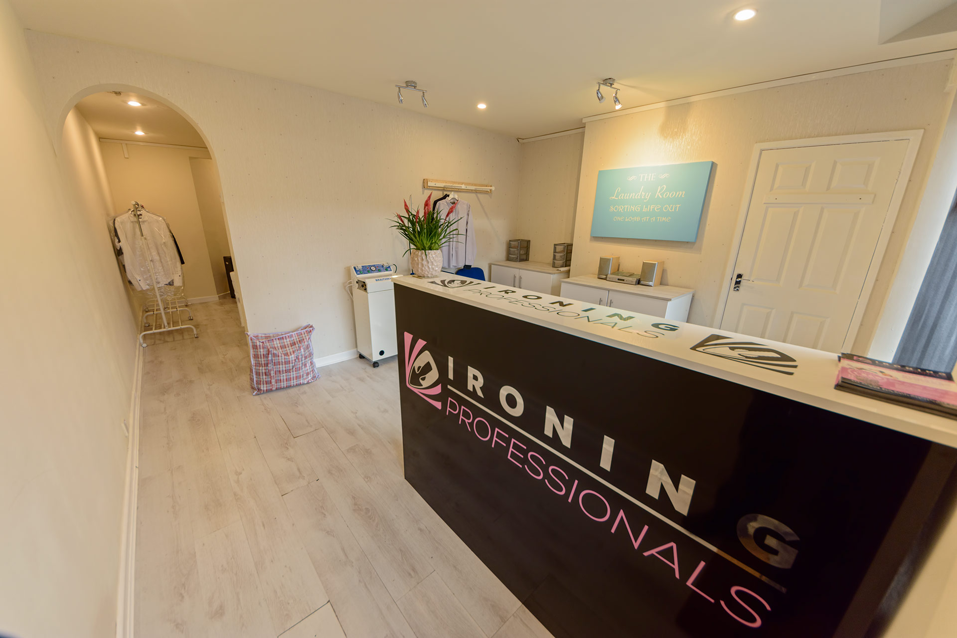 Our clean and tidy ironing shop in Horwich